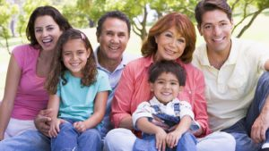 Colorado Springs Dental Extended family sitting outdoors smiling