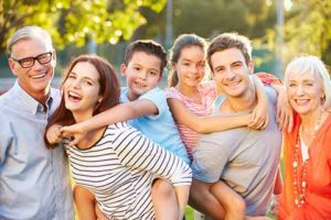 colorado springs dental laser treatment - smiling family